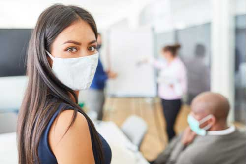 Young business woman in face mask, Covid-19