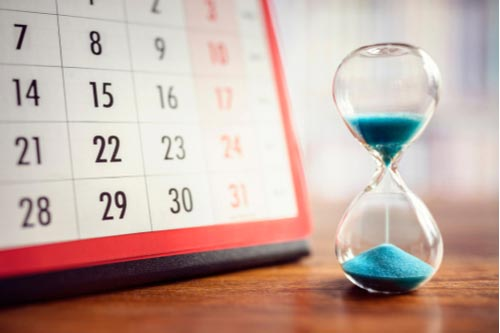 Calendar and hourglass, workers' comp deadline in Florida concept
