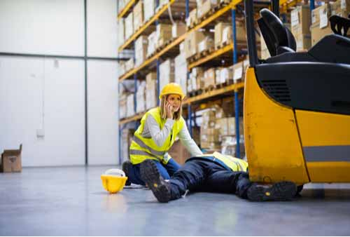 Injured warehouse worker, concept of Amazon workers' compensation