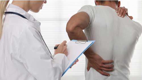 Doctor determining Coral Gables maximum medical improvement