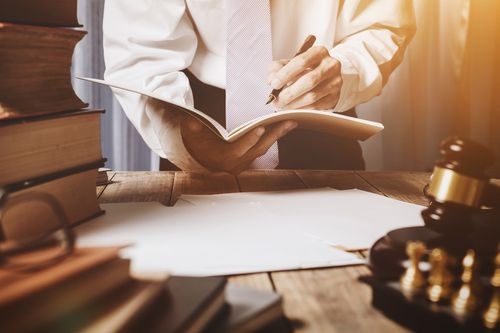Orlando workers' compensation lawyer reading Florida workers' comp laws