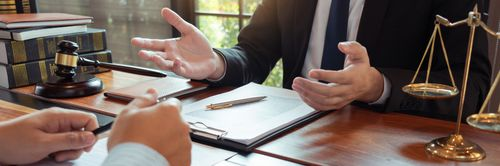 Lawyer and client discussing compensable work injuries in Orlando