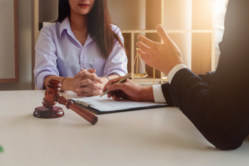 Lawyer and client discussing the workers' compensation claims process in Boca Raton