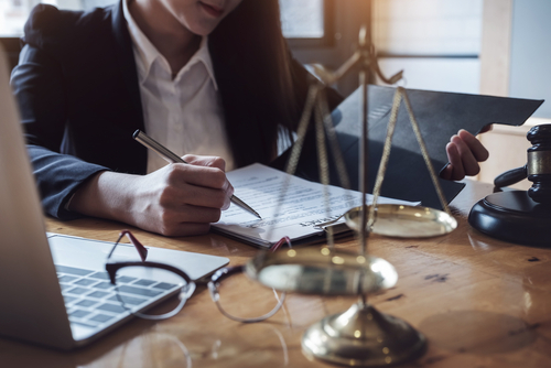 Orlando workers' compensation lawyer reviewing clients workers' comp case
