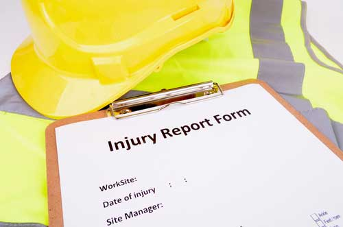 Clipboard with form for reporting a work injury in Fort Myers