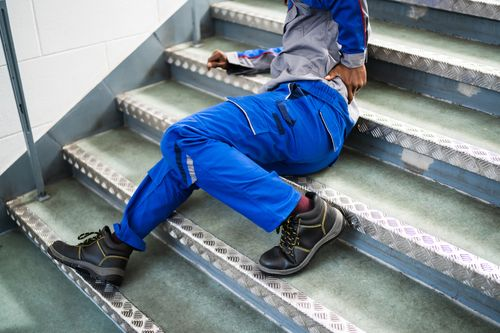 Image is of a man that slipped on steps at work and hurt back and will need to begin the workers' compensation claims process in Fort Lauderdale