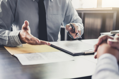 Lawyer discusses workers' compensation disputes in Orlando with client