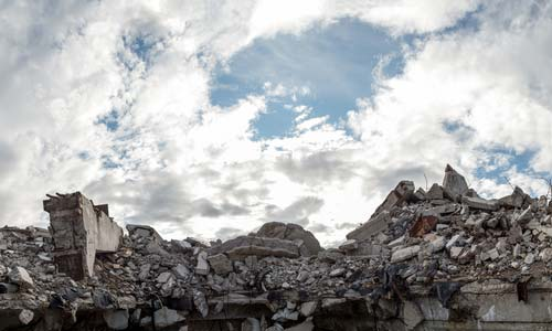 Rubble after building collapse, workers' comp concept