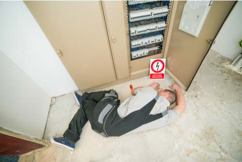 Injured worker on ground after electrocution accident