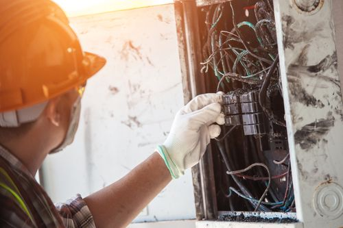 Worker inspecting circuit breaker that can cause a burn injury
