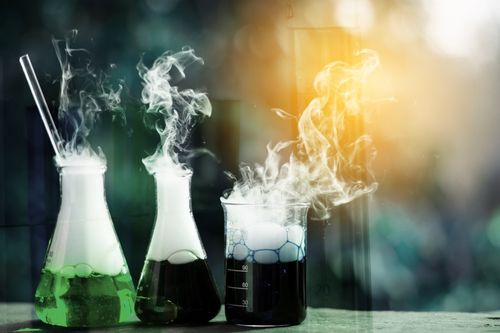 Chemical reaction and bubbling in science beaks concept of exposure to chemicals on the job