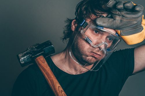 Construction worker hurting from repetitive stress injuries