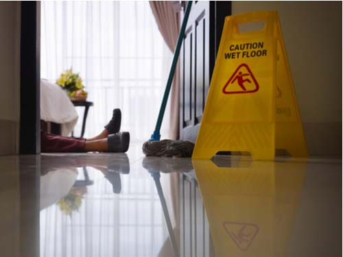 Hotel work injuries, hotel maid on floor after fall