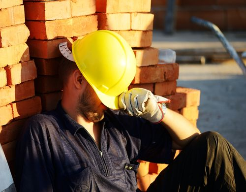 Construction worker with overexertion injuries