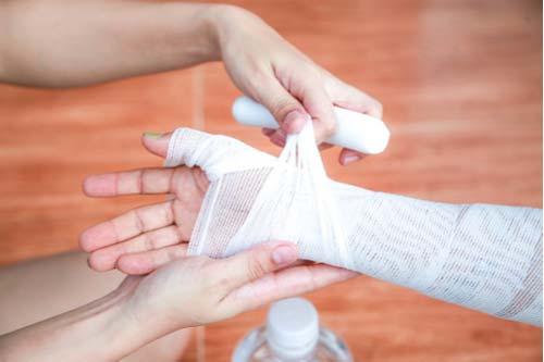 Bandage on hand burned in restaurant accident