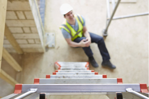 Construction worker hurt after fall off ladder concept of scaffolding / ladder accident