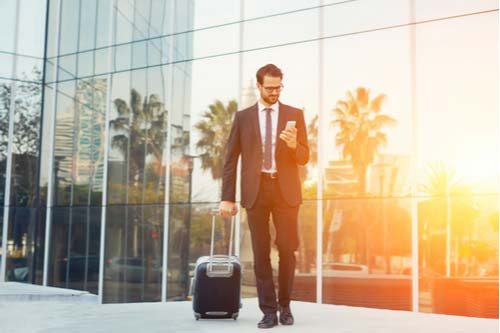 Businessman traveling for work, concept of workers' compensation