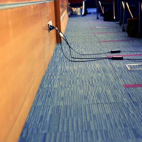 Wires running along the office floor concept of slip and fall accidents at work
