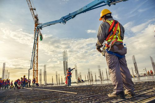 Worker supervising crane work on construction site concept of crane accidents