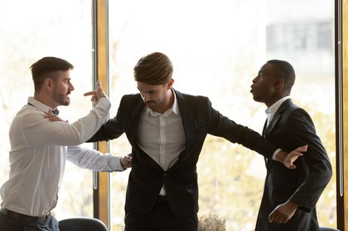 two men fighting in workplace violence
