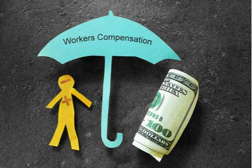 Paper man and money under umbrella labeled workers' compensation