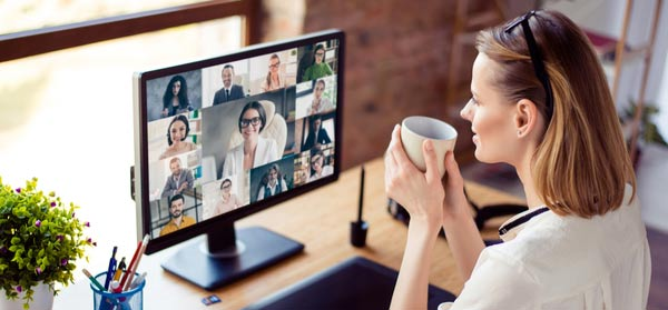 Woman using computer webcam for business meeting, remote work