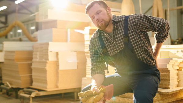 Man with back injury workers' comp